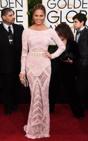 I am in love with this dress. Everyone keeps going on and on about Chrissy; I've given into the hype. After seeing this dress, I'm starting to understand what everyone's talking about.