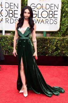 Drag persona Conchita Wurst looked absolutely . I loved the emerald shade with her complexion and hair. A+.
